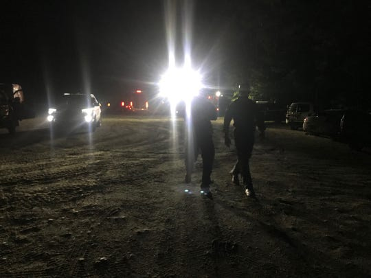 This image shows police vehicles parked Wednesday evening, Aug. 29, 2018, on a back road west of Morrisville in the foothills of Sterling Mountain. Vermont State Police, Morrisville Police and Stowe Police searched for a Stowe Soaring glider carrying three people that went missing earlier in the day.