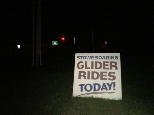 """A sign placed by Stowe Soaring at Morrisville-Stowe State Airport advertises """"Glider Rides Today!"""" A glider that went aloft with a tow plane from the airport went missing on Wednesday afternoon, Aug. 29, 2018."""