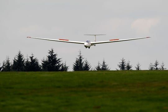 A glider comes into land at the Yorkshire Gliding Club in Thirsk, England, in this picture from 2011. Towed into the sky  by an aircraft called a tug, the gliders are then released and can ride  thermals for a considerable amount of time without an engine to propel them.
