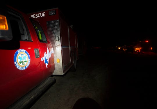 Stowe Mountain Rescue vehicles sits at a remote trail head near Sterling Mountain late Wednesday night, Aug. 29, 2018, as dozens of rescuers scoured the mountain for a glider that went missing and was spotted deep in the woods.