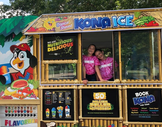 Delaney (left) and Riley Purdy enjoy helping out out on the Kona Ice truck. 'It's definitely brought us closer,' says Delaney.