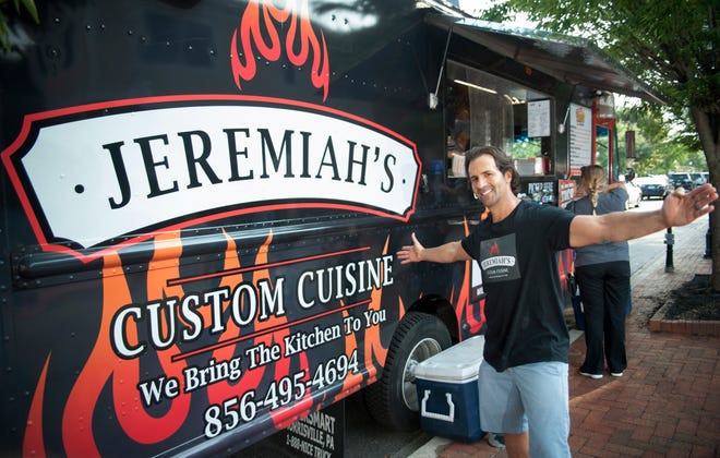 Jeremiah Bodner stands by his food truck during the Moorestown Food Truck Festival in late August. Jeremiah's Custom Cuisine offers a choice of four different themes for events, private and corporate clients.