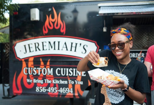 Briana Harrison of Lumberton dines on tacos from Jeremiah's Custom Cuisine food truck during the Moorestown Food Truck Festival.
