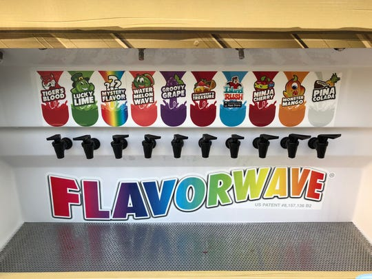 The Kona Ice truck operated by Ed and Sara Purdy features a variety of self-serve syrups in a dispenser called the Flavorwave. The Purdys will soon set up a Kona kiosk, including 'Krafted Flavors' such as black cherry and pina colada, in the Cherry Hill Mall.