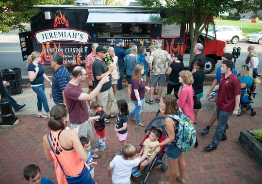 A crowd gathers around Jeremiah's Custom Cuisine food truck in August during the Moorestown Food Truck Festival.