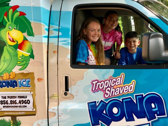 Chloe (left), Delaney and Edward Purdy help their parents run a Kona Ice truck. The family just launched the business, but already has many weekend dates booked through September and October.