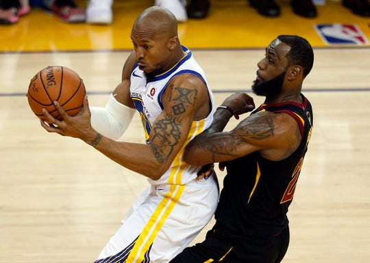 Golden State Warriors forward David West (3) moves to the basket against Cleveland Cavaliers forward LeBron James (23) in game one of the 2018 NBA Finals at Oracle Arena.