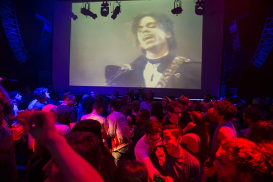 """A crowd pays tribute to Prince inside First Ave where """"Purple Rain"""" was filmed late Thursday, April 21, 2016 in Minneapolis. Prince, widely acclaimed as one of the most inventive and influential musicians of his era with hits including """"Little Red Corvette,"""" ''Let's Go Crazy"""" and """"When Doves Cry,"""" was found dead at his home on Thursday in suburban Minneapolis, according to his publicist. He was 57."""