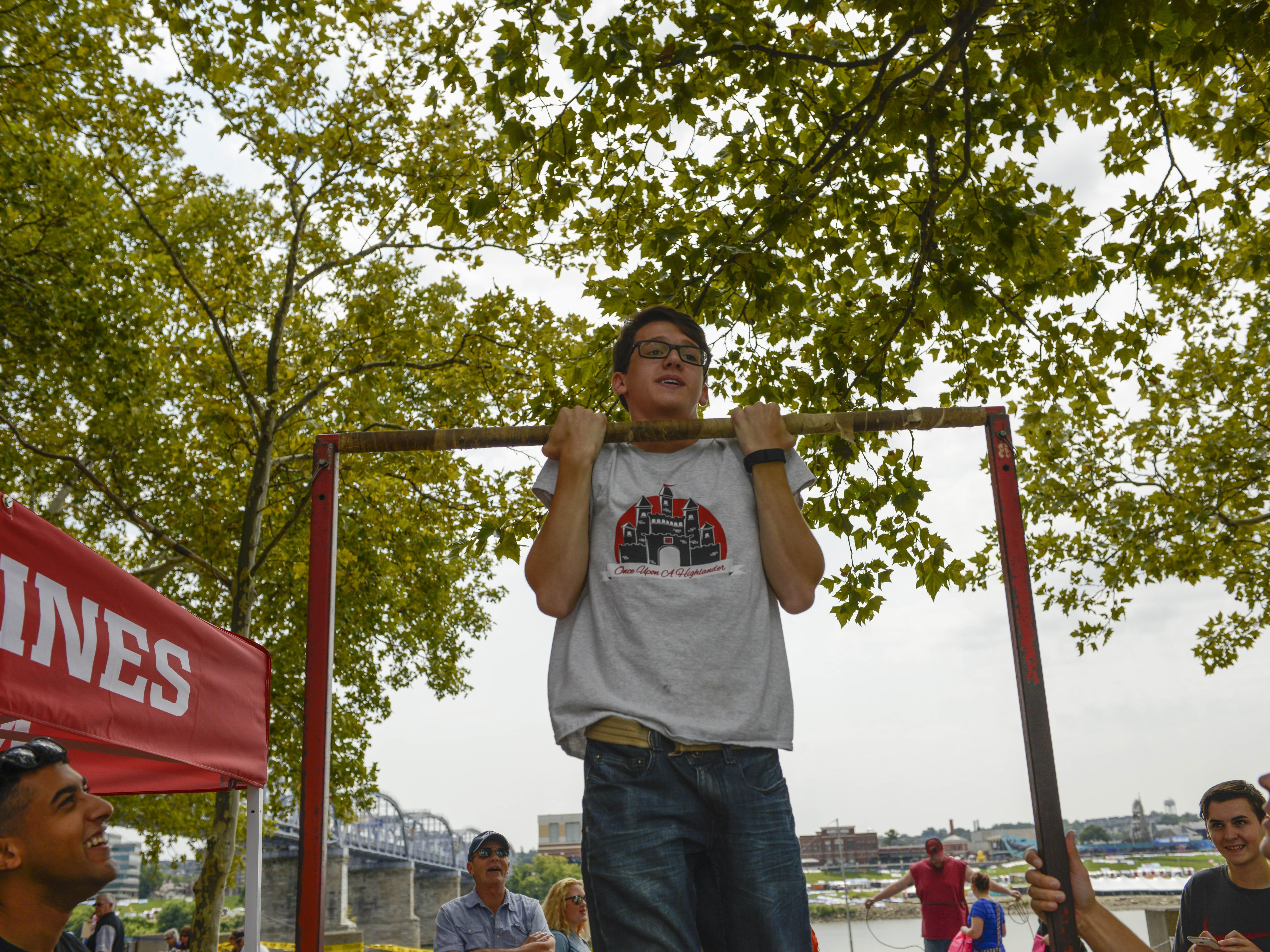 photos by Joe Simon/for the Enquirer Carter Loewenstine shows off his strength at the U.S. Marine Corps chin-up bar at the 41st annual Riverfest. The 41st. annual W&S WEBN Fireworks was held Sunday,September 3,,2017 on the banks of the Ohio River. Carter Loewendtine shows off his strength at the USMC chin up bar.
