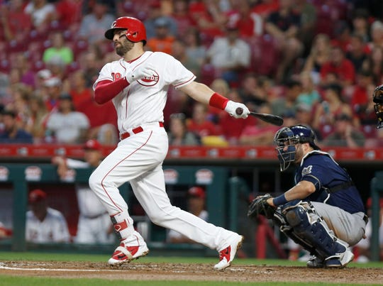 Cincinnati Reds first baseman Curt Casali (38) hits an RBI single against the Milwaukee Brewers during the second inning at Great American Ball Park.