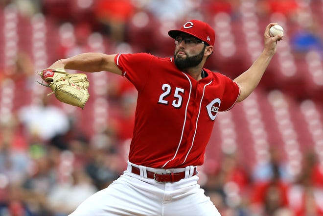 Aug 30, 2018; Cincinnati, OH, USA; Cincinnati Reds starting pitcher Cody Reed (25) throws against the Milwaukee Brewers in the second inning at Great American Ball Park. Mandatory Credit: Aaron Doster-USA TODAY Sports