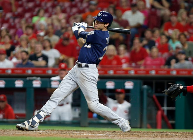Milwaukee Brewers center fielder Christian Yelich (22) hits a double against the Cincinnati Reds during the sixth inning at Great American Ball Park.