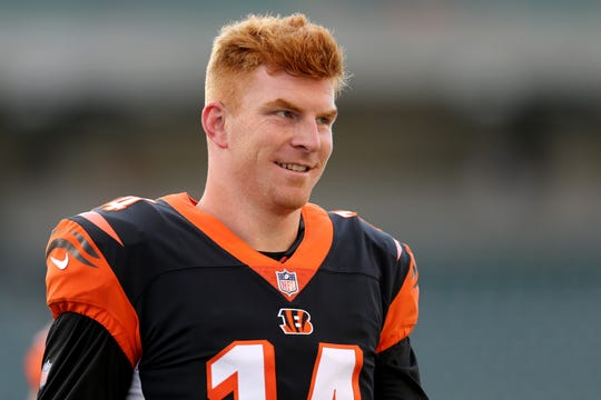 Cincinnati Bengals quarterback Andy Dalton (14) greets teammates before the Week 4 NFL preseason game between the Indianapolis Colts and the Cincinnati Bengals, Thursday, Aug. 30, 2018, at Paul Brown Stadium in Cincinnati.