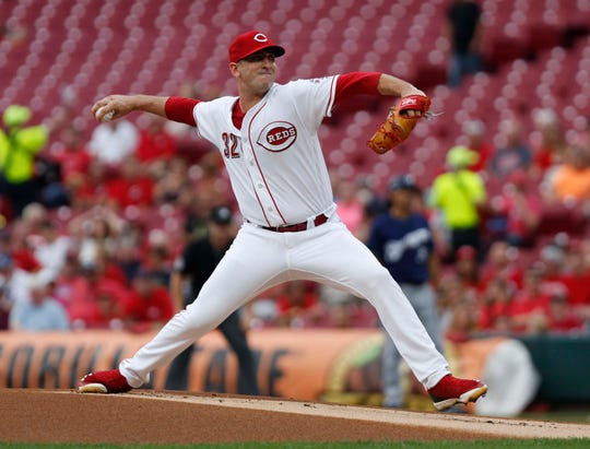 Cincinnati Reds starting pitcher Matt Harvey (32) throws against the Milwaukee Brewers during the first inning at Great American Ball Park.