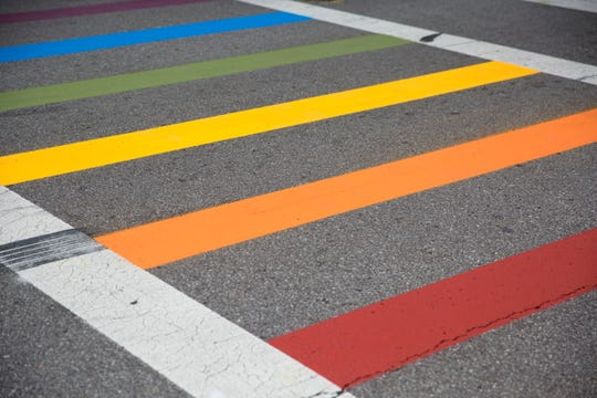 The new rainbow crosswalk at 12th and Vine Street in Over-the-Rhine. Private donations paid for the makeover and city and county leaders, along with representatives from the LGBTQ helped celebrate the new Pride crosswalk.
