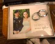 A wedding picture was found broken after the Cacho family's military move from Fort Campbell to Fort Belvoir, Va., this summer.
