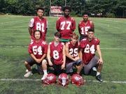 Highland Park football players (front row) Andy Lan, Ray Faso, Michael Adamczyk-Zapor, Brandon Doss (back row) Donavan Crawford, Ramone Valentine, Romelo Haskins