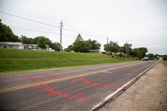 Deport illegals is painted onto Bloomfield Road on Thursday, Aug. 30, 2018, on the south side of Des Moines.