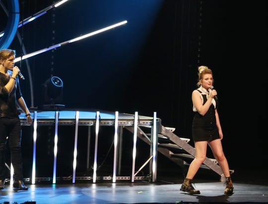 """Maddie Poppe on stage with the """"American Idol"""" tour."""
