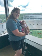 Nicole Knapp holds her daughter, Kaeli Knapp, born this May with a rare congenital heart defect.