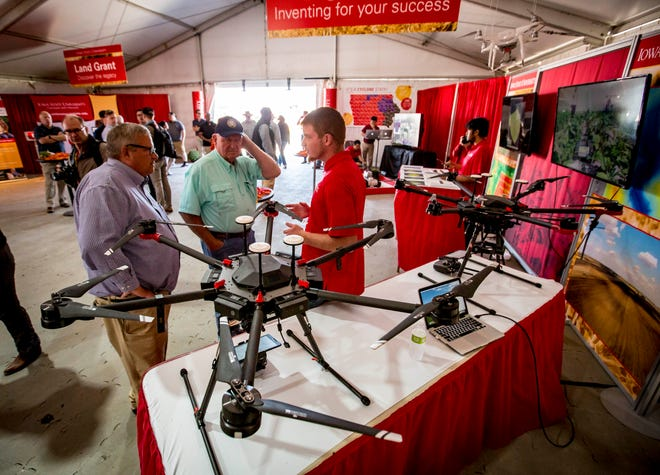 U.S. Secretary of Agriculture Sonny Perdue, center, and Under Secretary for Farm Production and Conservation Bill Northey tour drone display at the ISU pavilion at the Farm Progress Show on Aug. 29 near Boone.