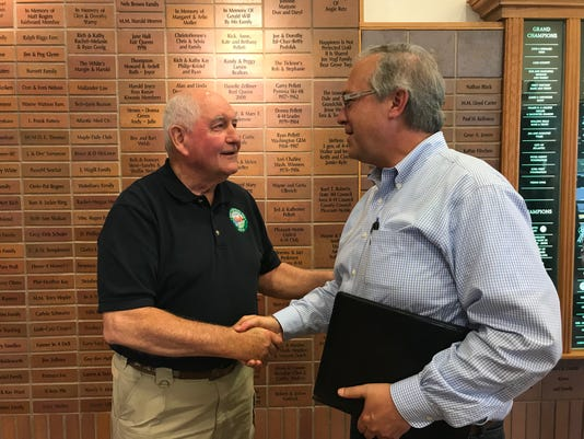 David Young and Sonny Perdue at Aug. 2018 town hall meeting