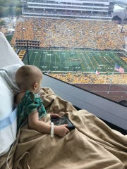 Wyatt Hemphill, while being treated for a rare immune deficiency at the Stead Family Children's Hospital, watches the University of Iowa Hawkeyes game against North Texas in September 2017.