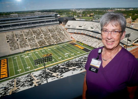 """Gwen Senio, manager of the child life program at UIHC stands for a photo in the """"Press Box"""" where kids can watch the Hawkeyes and the wave Aug. 29, 2018."""