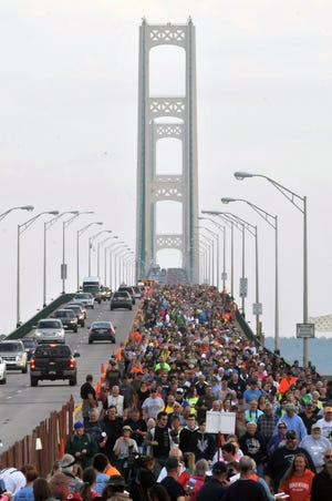 Walkers used to share the Mackinac Bridge with vehicular traffic for the annual Labor Day walk, as shown in this photo from 2014. But starting last year, the bridge is entirely closed to vehicles for the walk, for safety reasons.