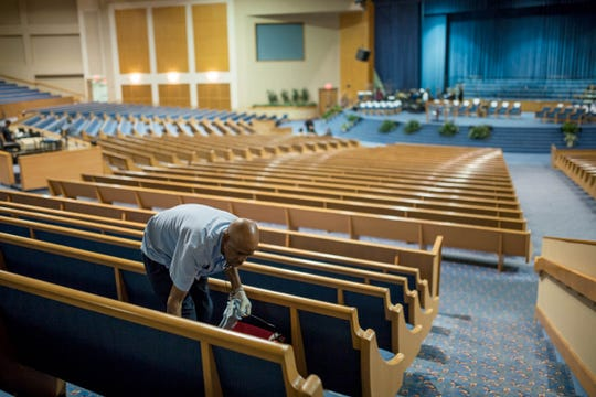 Greater Grace Temple maintenance worker David Brewer of Detroit cleans pews on Wednesday, August 29, 2018 as preparation continues for the funeral of the late Aretha Franklin at the Detroit church.