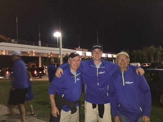 Brighton attorney Bob Gardella (left) joins his son Bobby, 17, and his father Bob, Sr., 78, for the Mackinac Bridge Walk almost every Labor Day.