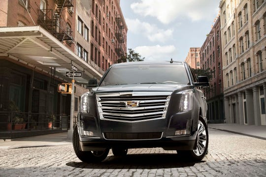 With its imposing grille and stacked lighting, the Cadillac Escalade cuts an iconic figure.