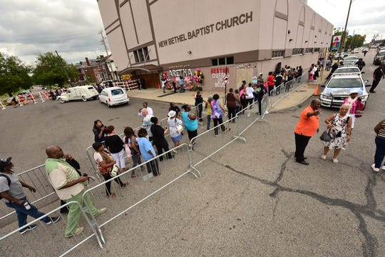 A line forms outside New Bethel Baptist Church for Thursday's viewing.