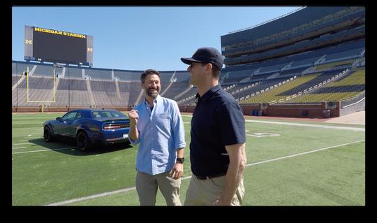 Filmmaker Jeffrey Phelps with  Coach Jim Harbaugh.
