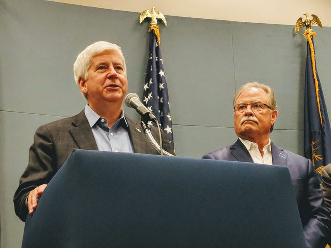 Gov. Rick Snyder and Michigan Chamber of Commerce CEO Rich Studley talk fee proposal on Aug. 30, 2018.