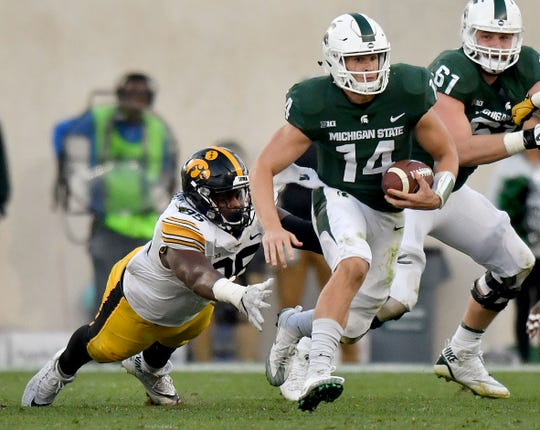 Michigan State quarterback Brian Lewerke averaged 4.5 yards per carry last season, matching running back LJ Scott.