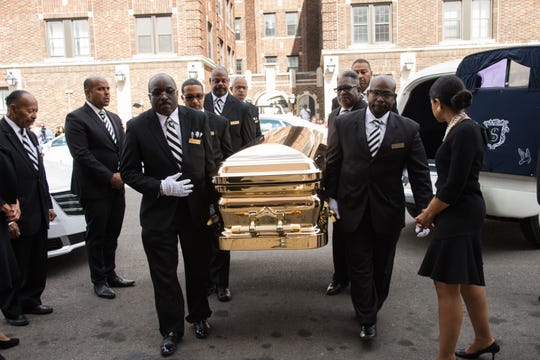 The casket bearing Aretha Franklin is carried into New Bethel Baptist Church Thursday.