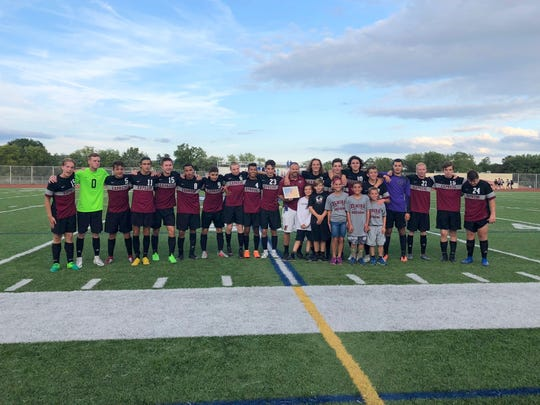 The Elmira boys soccer team poses for a photo after a 2-0 win over Corning on Aug. 30 at Ernie Davis Academy that gave coach Derek Hamilton his 100th career victory.