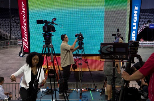 Media prepares for President Donald Trump's campaign rally at the Ford Center in Evansville, Ind., Thursday.