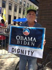 Protester Jeff Ruthenburg of Evansville stood at a corner across the street from President Donald Trump supporters Wednesday morning, holding a sign in support of former President Barack Obama and former Vice-President Joe Biden.