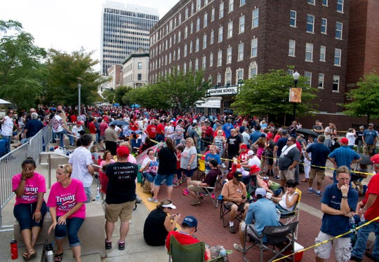 Crowds gather on Main Street for President Donald Trump's campaign rally at the Ford Center in Evansville, Ind., Thursday morning.