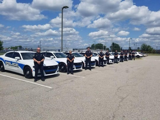 Henderson Police Department officers pose for a photo before helping control traffic in Evansville during President Donald Trump's visit.
