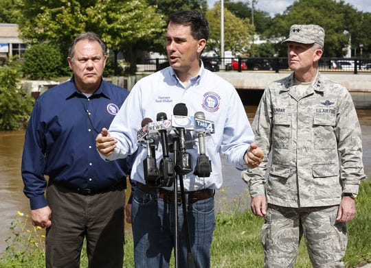 Wisconsin Governor Scott Walker addressed media members Thursday in Fond du Lac, about plans to tour areas affected by storms in Fond du Lac and Dodge Counties. Also at the press conference were Brian Satula of Wisconsin Emergency Management, at left, and Donald Dunbar of the Wisconsin National Guard.