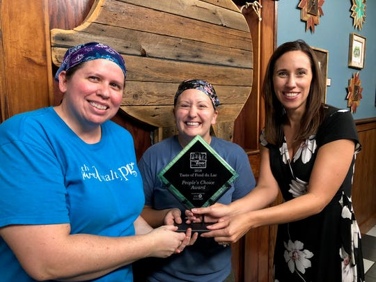The Sweet & Salty Pig won the People's Choice Award at the 2018 Taste of Fond du Lac event. Pictured are, from left: owners Janis Michaels and Allison Gossman, and Vice President/ Bank Manager at BMO Harris Bank in Fond du Lac Kasey Woxland.