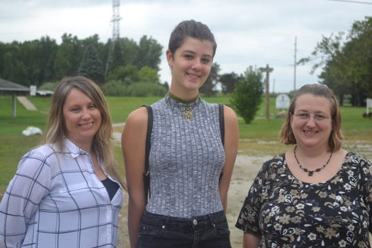 Administrative Assistant Megan Wonderly, left, and Camp Director Julie Young, nominated fourteen-year-old Lydia Kropp for the Boyk Law's Bikes for Kids program, which gives free bikes to kids who are making an impact in their community.