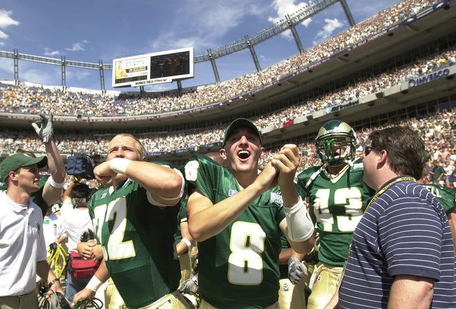 Justin Holland (8) and his CSU teammates celebrate after beating CU 19-14 in the 2002 Rocky Mountain Showdown at Invesco Field at Mile High.
