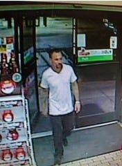 Surveillance photo from July robbery at Del Prado 7-Eleven. Police have identified the suspect as Daniel Patrick Sullivan, who is in an Orange County, Calif., jail on a violation of parole charge.