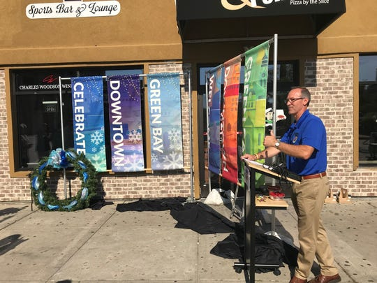 Downtown Green Bay has purchased new light pole banners and materials to spruce up its holiday wreaths as part of a new beautification effort.