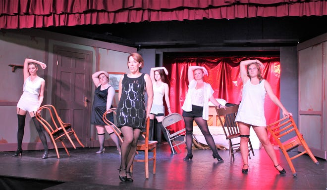 "Brigette Finger, front, rehearses her role as Sally Bowles in the musical ""Cabaret,"" backed by the Kit Kat Dancers, from left, Ali Carlson, Elizabeth Jolly, Abby Frank, Jennifer Hibbard and Morgan Blau. ""Cabaret"" will be performed Sept. 13-16 and 20-23 at the Byng Community Theater in Abrams."