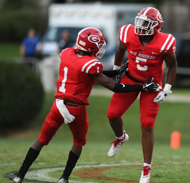 Greenville cornerback Jalen Tate (1) and defensive end Reggie Norris (5) celebrate a big play in Week 0 against Woodmont. The Red Raiders will travel to BHP Friday.